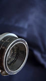 Vintage lens on blue   background Royalty Free Stock Images