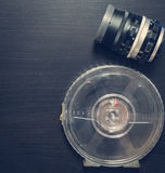 Vintage Lens with Movie Film roll on black background Royalty Free Stock Photo