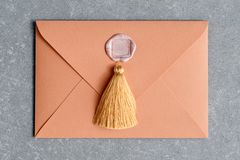 Vintage letter envelope with wax seal and tassel on concrete background. Flat lay. stock images
