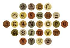 Vintage letter set. Old fashioned letters on vintage circle backgrounds Stock Images