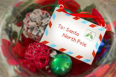 Vintage letter to Santa Claus in a glass bowl of Christmas decor royalty free stock photo