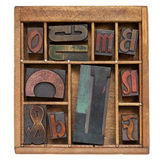 Vintage letterpress printing blocks Stock Photography