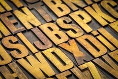 Vintage letterpress wood type printing blocks. Background of random vintage letterpress wood type printing blocks stained by color inks Stock Photography