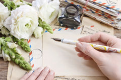 Vintage letters, ink and pen. White persian buttercup flowers Stock Photo