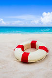 Vintage Life buoy on the sand at the beach Royalty Free Stock Photo