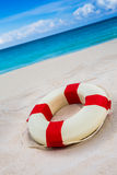 Vintage Life buoy on the sand at the beach stock image