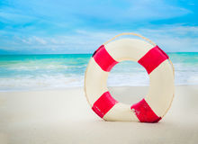 Vintage Life buoy on the sand at the beach stock photography