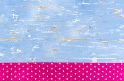 Vintage light blue wooden texture with pink star shape pattern textile border and copy space Stock Photo