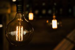 Vintage light bulb closeup with dark background royalty free stock images