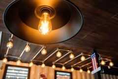 Vintage light bulb in coffee shop,classic and retro concept styl Stock Photography