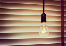 Vintage light bulb decorate in modern cafe. Close up of vintage light bulb decorate in modern cafe Stock Photos