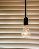 Vintage light bulb decorate in modern cafe. Close up of vintage light bulb decorate in modern cafe Royalty Free Stock Photography