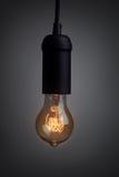 Vintage light bulb glowing Stock Image