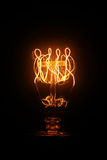 Vintage light bulb glowing Royalty Free Stock Image