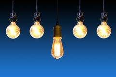 Vintage light bulb hanging over dark blue background, Idea concept stock photography