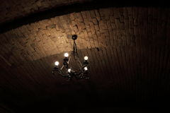 Vintage Light 2. Vintage chandelier at the ceiling of a cellar Royalty Free Stock Photos