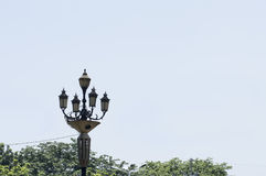 Vintage Four-Way Outdoor Light Post. This kind of four-way lamp styled post is located in the streets of Intramuros in Manila Stock Photo