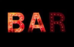 Vintage lightbulb bar sign Stock Photography