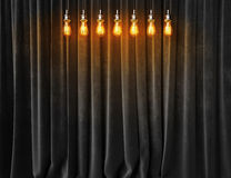 Vintage lightbulbs on velvet curtains background Stock Photography