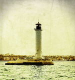Vintage lighthouse. Photo of an old lighthouse Royalty Free Stock Photography
