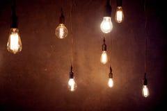 Vintage Lighting decor, lot of light bulbs hanging Royalty Free Stock Image