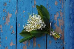 Vintage Lily of the valley bouquet stock photography