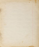 Vintage lined paper background. Blank copybook textured page with spots Royalty Free Stock Photography
