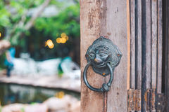 Vintage Lion Door-Knobs,Background Coffee Shop Blur. Vintage Lion Door-Knobs,Background Coffee Shop Stock Photography