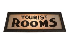 Vintage lit Tourist Rooms Hotel Sign. Isolated on white Royalty Free Stock Images