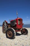 Vintage little red beach tractor Stock Photos