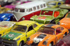 Vintage little toy cars. Small colorful vintage model toy cars Stock Photos