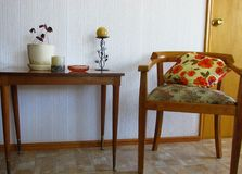 Vintage living room. Interior of living room with wooden armchair and table. stock photography