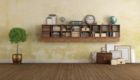 Vintage living with wooden bookcase Stock Photos