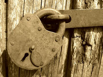 Vintage lock. And wall, sepia mode Royalty Free Stock Image