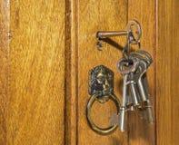 Vintage lock and keys on walnut Stock Photos