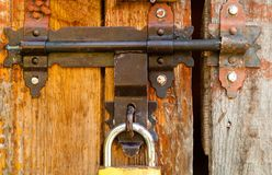 Vintage lock on a rusty loop on a wooden background, copy space,concept of authentic objects stock photos