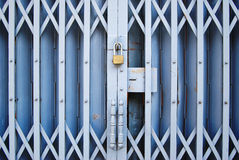 Vintage locked old metal door Stock Images