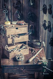 Vintage locksmiths workshop with tools, locks and keys Stock Photography