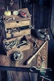Vintage locksmiths workshop with tools to repair Stock Images