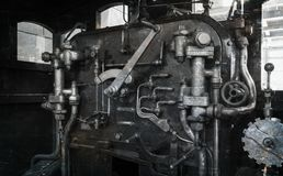 Vintage locomotive - Controling an old train. The Netherlands Royalty Free Stock Image