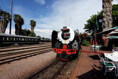 Vintage locomotive steam train against blue sky Stock Photos