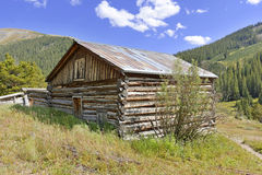 Vintage log cabin in old mining town in the mounta Royalty Free Stock Photography