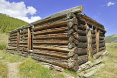 Vintage log cabin in old mining town in the mountains Royalty Free Stock Image