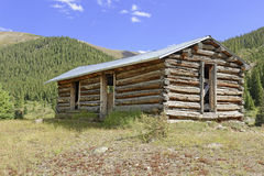 Vintage log cabin in old mining town in the mountains Stock Image