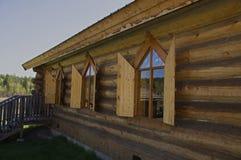 Vintage Log Church shutters Royalty Free Stock Photo