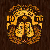 Vintage logo for a boxing - gold on wood Royalty Free Stock Photography