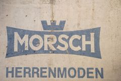 Vintage Logo Morsch menswear. Saarbruecken, Germany - July 29, 2018: The Vintage Logo of Morsch mens fashion house on a beige brick facade on July 29, 2018 stock image