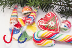 Vintage lollipops under the Christmas tree Stock Image