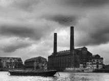 Vintage London. A vintage picture of a factory in London near a river stock images