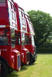 Vintage London red buses. A line of vintage London red buses Royalty Free Stock Image